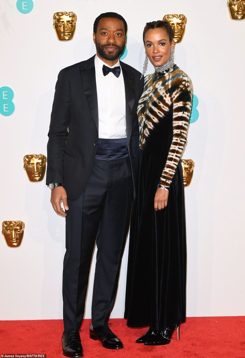 Dapper: Chiwetel Ejiofor looked handsome in a bow-tie as he posed with his stunning parnter Frances Aaternir