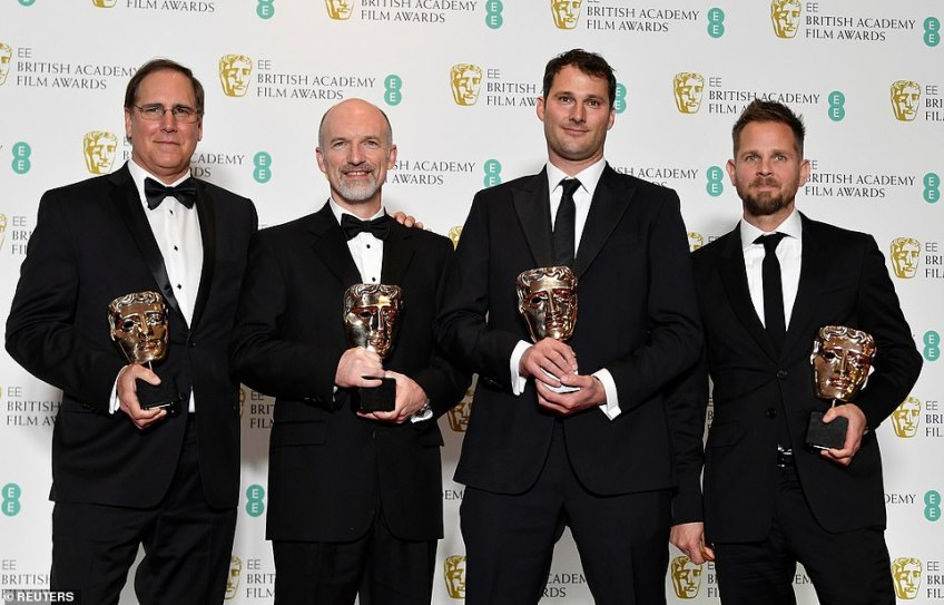 Amazing accolade:Daniel Sudick, Craig Hammack, Geoffrey E. Baumann and Jesse James Chisholm hold their award for Special Visual Effects for the film Black Panther