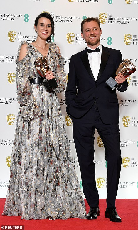 Bright stars:Lauren Dark and Michael Pearce hold their awards for Outstanding Debut by a British Writer Director or Producer