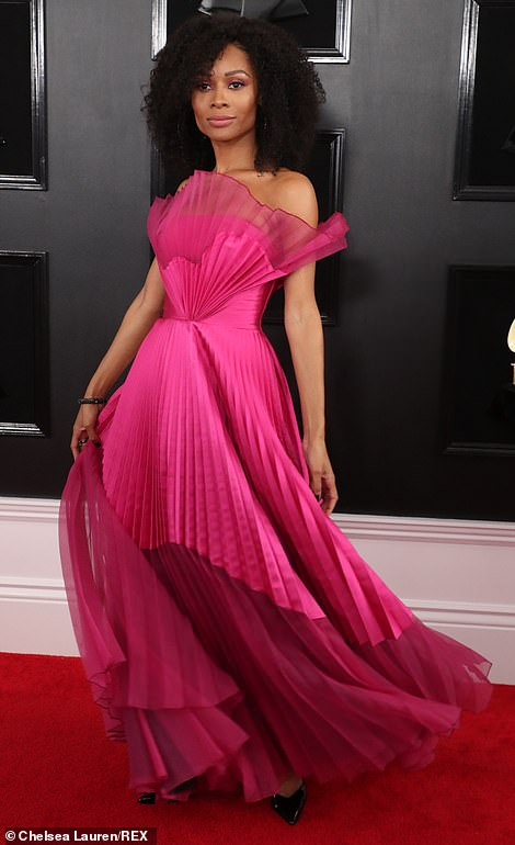 Tickled pink! E! News correspondent Zuri Hall was pretty in pleated pink