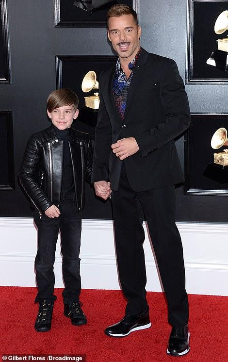 Family affair: Ricky Martin brought along his son