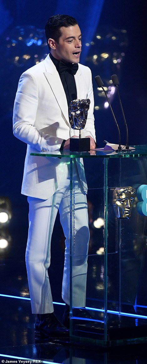 His moment: Rami was clearly overwhelmed with excitement as he continued delivering his speech on the podium