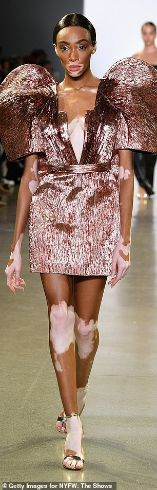 Winnie Harlow, right, had on a very eye-catching pink mini dress with short sleeves