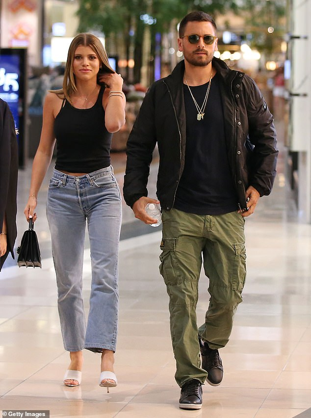 His new boo: Scott has been linked to 20-year-old model Sofia Richie for almost two years now. The pair are seen in Australia last November above
