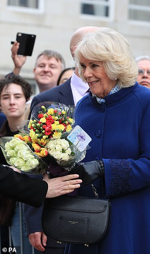 At one point it seemed that Camilla had her hands full literally as someone stepped in to help carry her bouquets