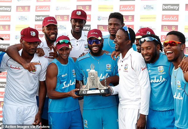 West Indies celebrate their series victory despite a heavy 232-run defeat in the third Test