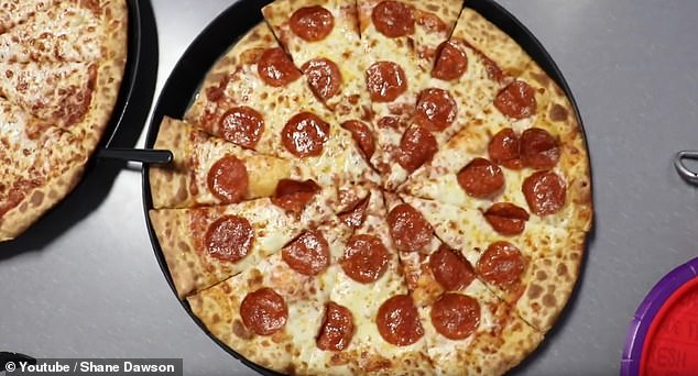 Dawson shared this photo from a visit to a Chuck E Cheese, showing the disfigured pizza pies