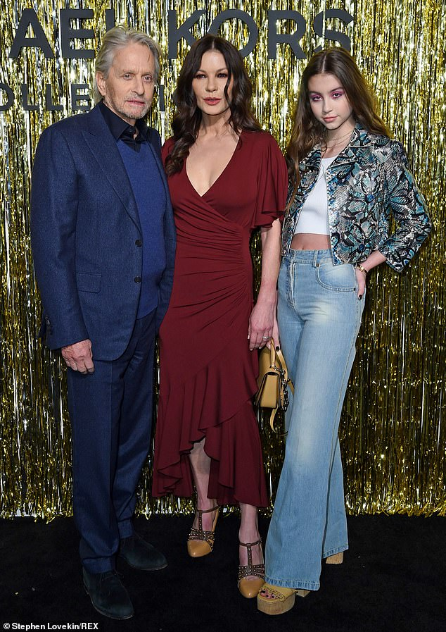 Family affair: Catherine Zeta-Jones looked was accompanied by husband Michael Douglas and 15-year-old daughter Carys at the Michael Kors Collection show on Wednesday