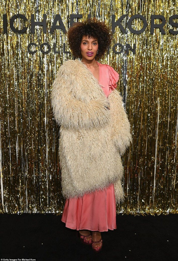No Scandal here!Kerry, 42, may have made the boldest fashion choice as she sported a white faux fur coat as she dropped one of the sleeves to show off her shoulder