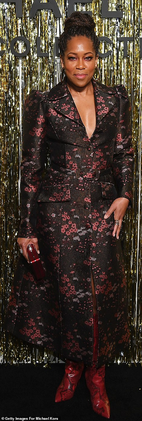 Stunning:The 48-year-old acting veteran looked stylish in a black floral patterned trench dress with red python leather booties