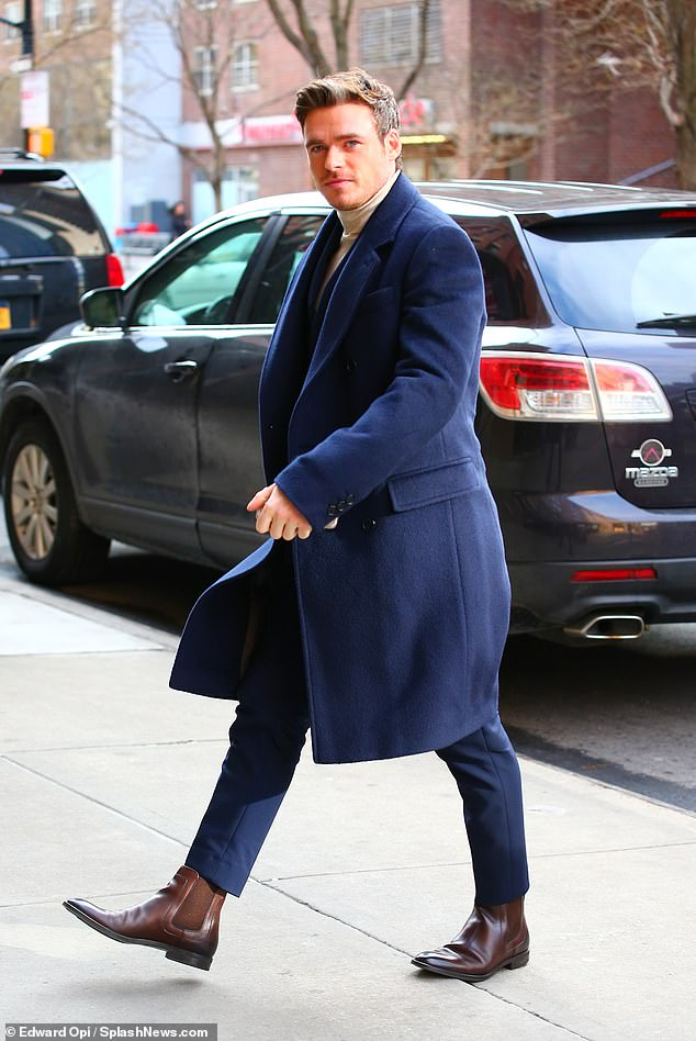 Leading man:The Scottish actor looked dapper as he stepped out for the fashion shows in a  royal blue suit