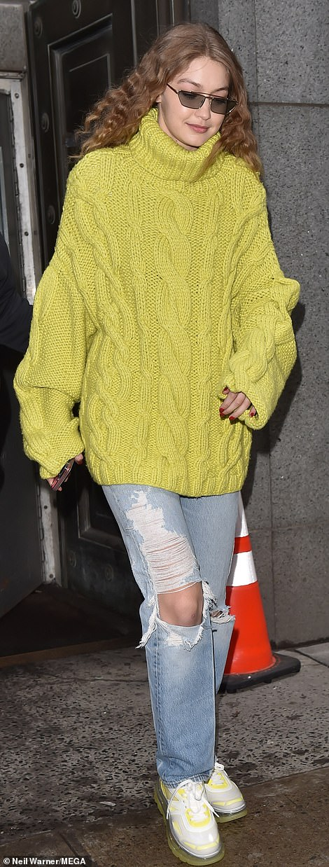 Out and about:Gigi sported a baggy lime green knit sweater along with ripped blue jeans and white and lime green trainers featuring a large air bubble as the sole