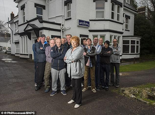 Landlady Wendy Hunt (centre) pictured above with tenants at the Belgravia Hotel in Bournemouth