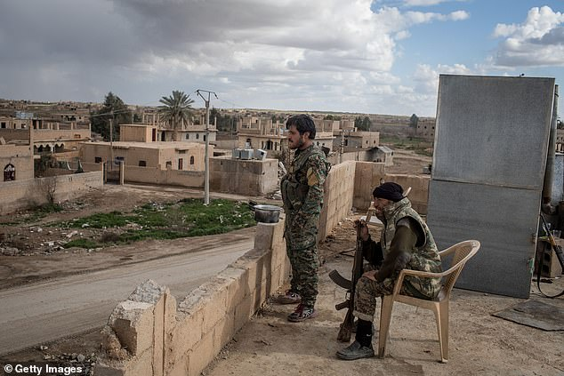 The fighters of Syrian democratic forces watch the suburbs of Baghouz, the last territory of ISIS in Syria. Kurdish-led fighters are supported by the United States