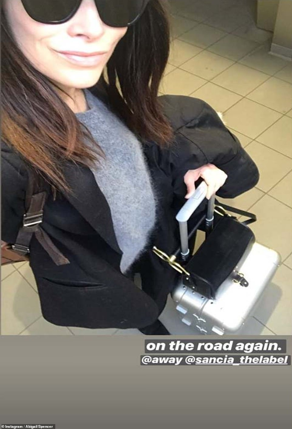 Headed to the Big Apple? Meghan's former Suits co-star Abigail Spencer took to Instagram Stories to reveal she was traveling on Monday, wheeling a silver Away carry-on suitcase with her, as well as a chic black handbag and a brown shoulder bag