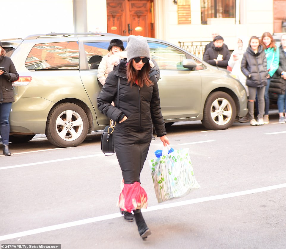 Audience: Crowds of people had begun to gather outside the hotel, watching Abigail closely as she walked into the venue, carrying a colorful plastic bag in her hand, which appeared to be housing a tissue paper-wrapped gift