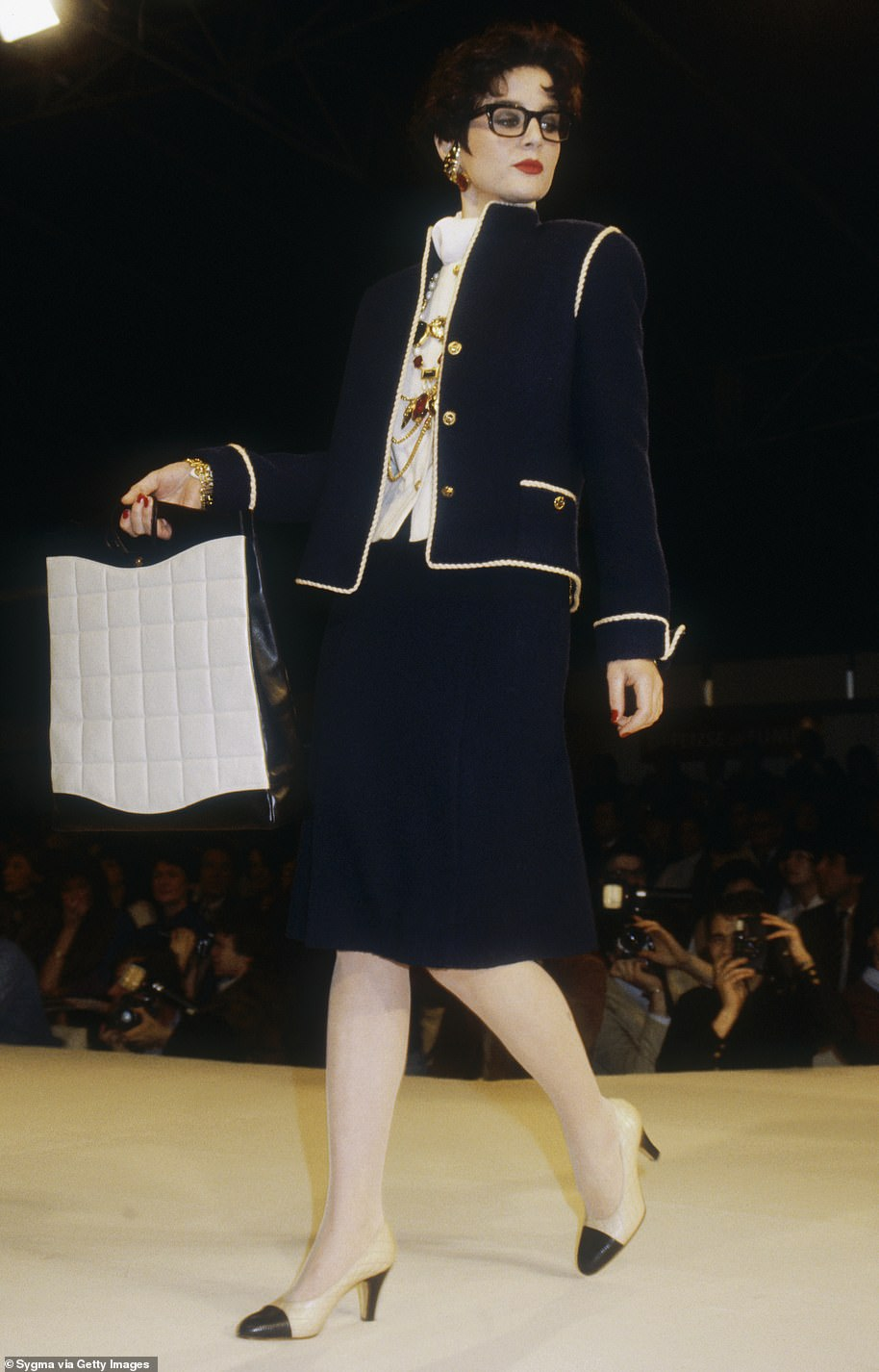 The way they were: A navy two-piece suit on the Chanel runway in Paris, one of Lagerfeld's first shows for the French fashion house's AW 1983-1984 collection