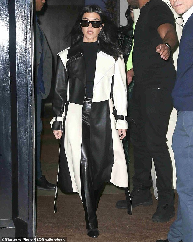 Checkered trench: the day after the NYFW was spotted in a black and white checkered trench, and later with a black look with a full length trench while checking his hotel