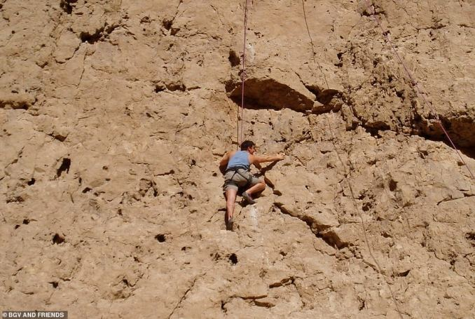 Bear pictured in October 2004 climbing in Oman on a trip with his wife Shara before they had their three boys. The adventurer mused: 'This was taken in a remote wadi, and was a special time - just her and me'