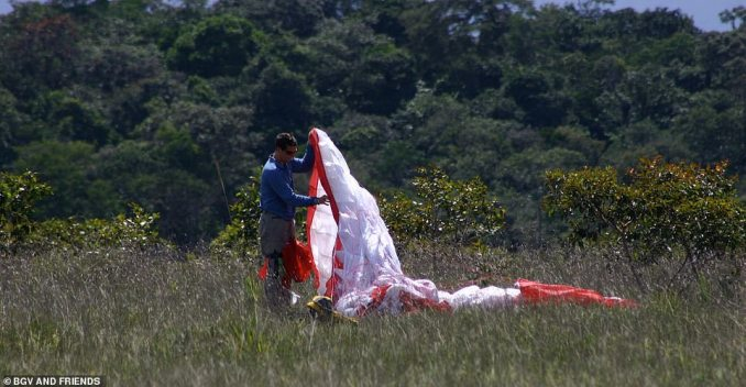 This picture shows Bear packing away a paraglider in the Venezuelan jungle before a failed attempt to fly over Angel Falls. He said: 'We were woefully unprepared for this trip, as new paraglider pilots who underestimated the intense humidity, heat and downpours'