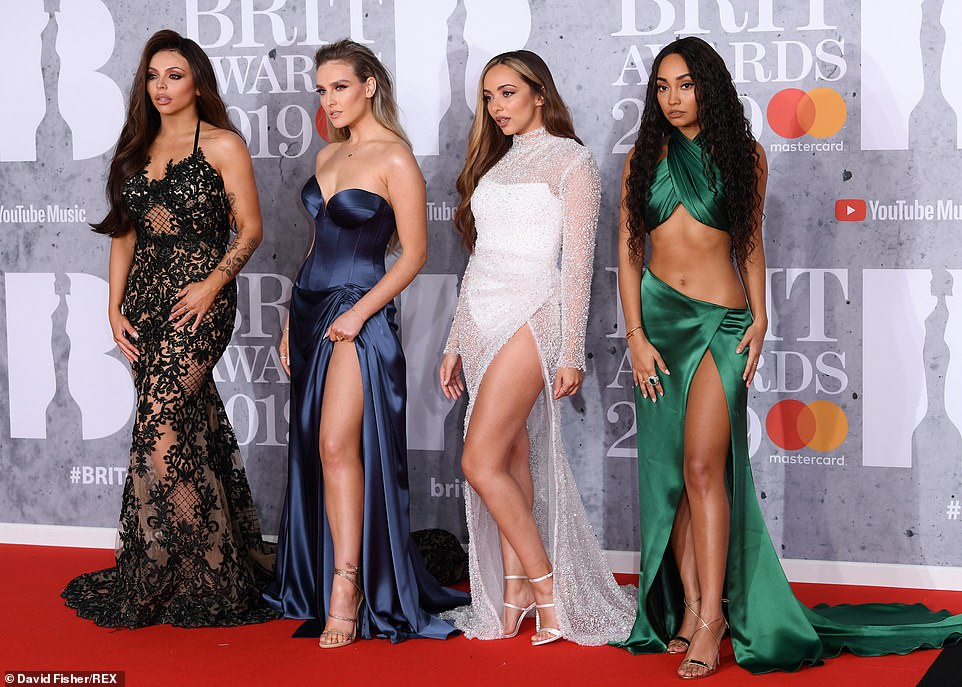 Battling it out: The girls - Jesy, Perrie, Jade and Leigh-Anne (from left to right) looked fierce as they posed up a storm