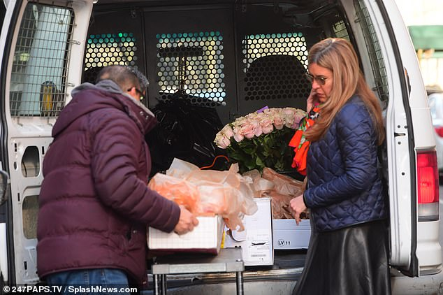 Gifts? A man and a woman were seen getting several different flower arrangements out of the back of a van, including the large bouquet of pink roses