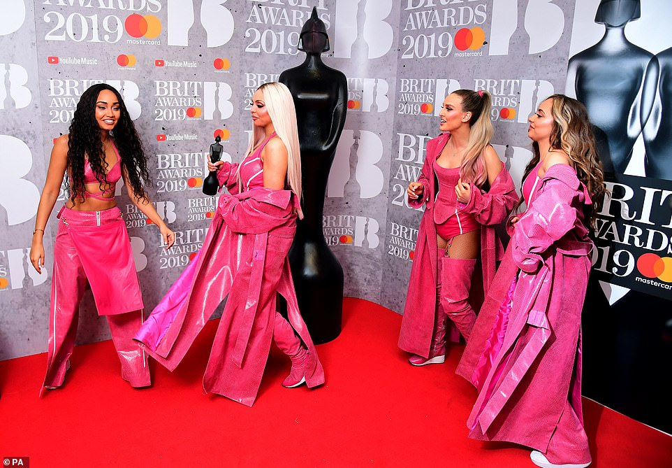 Happy: Little Mix appeared in good spirits as they giggled and smiled with each other for the photos