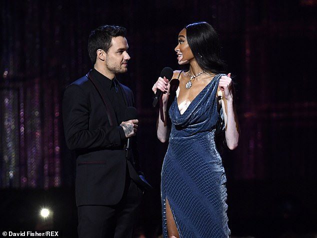 Awkward:The funnyman spared no effort on his puns as he joked the former One Direction star would be in a world of 'Payne' if he crossed the catwalk queen (Liam and Winnie)