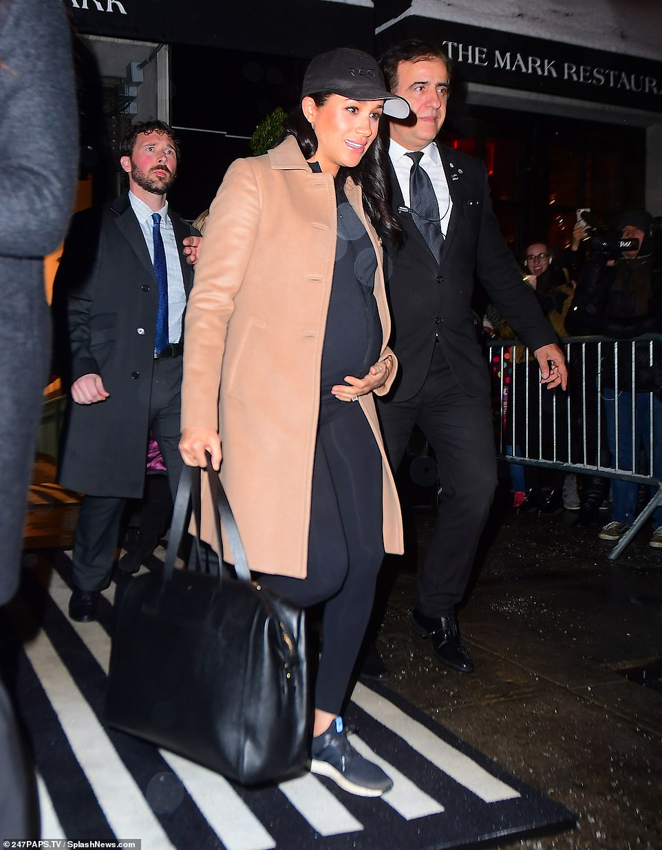 She's off! The pregnant duchess left the swanky Upper East Side hotel where her baby shower took place on Wednesday evening after the lavish soiree, cradling her bump as she made her way to a waiting SUV, and wearing the same tan coat