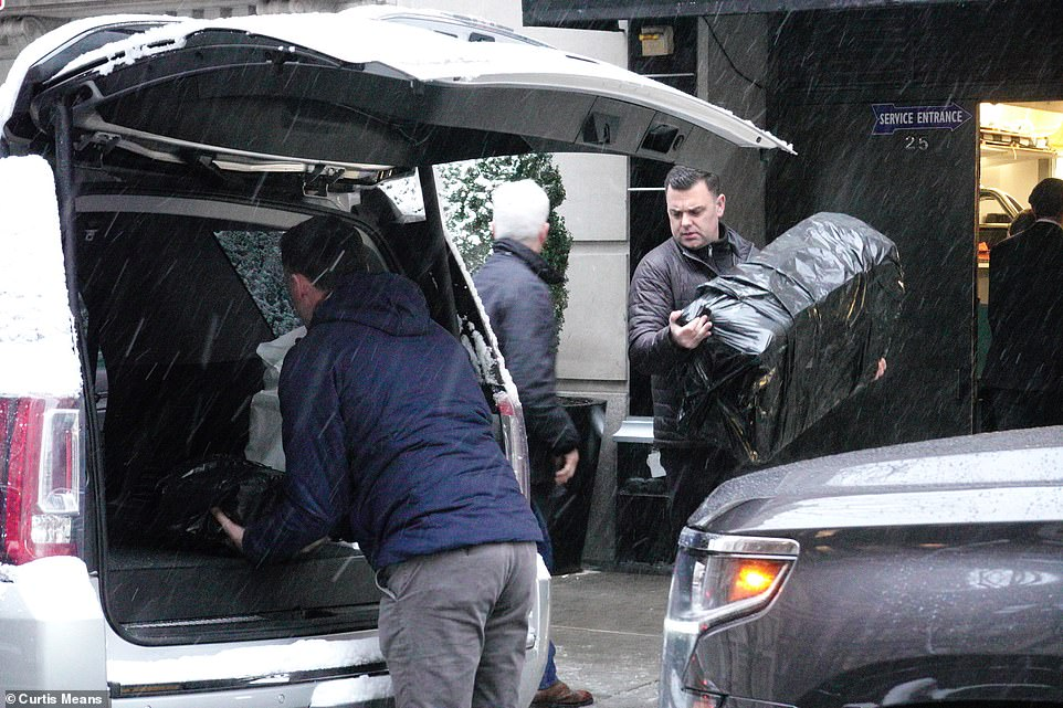 Swag? Several packages that appeared to be suitcases wrapped in black garbage bags were seen being loaded into the same SUV outside The Mark hotel, where Meghan stayed, and where her baby shower was hosted on Wednesday