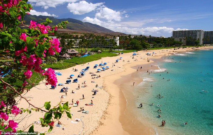 Ka'anapali Beach, which is around 50 minutes from Maui's Kahului Airport, landed at number 14 in the rankings for itswhite sands and crystal clear waters, which are perfect for snorkelling. One reviewer wrote: 'This beach seems to go on for miles and is a beautiful, pristine beach with a wonderful miles-long boardwalk full of restaurants, shops, crafts, etc. If you happen to have a hotel in Ka'anapali you don't even really need a car to enjoy all the beauty of Maui. The swimming and snorkelling is awesome from this beach'