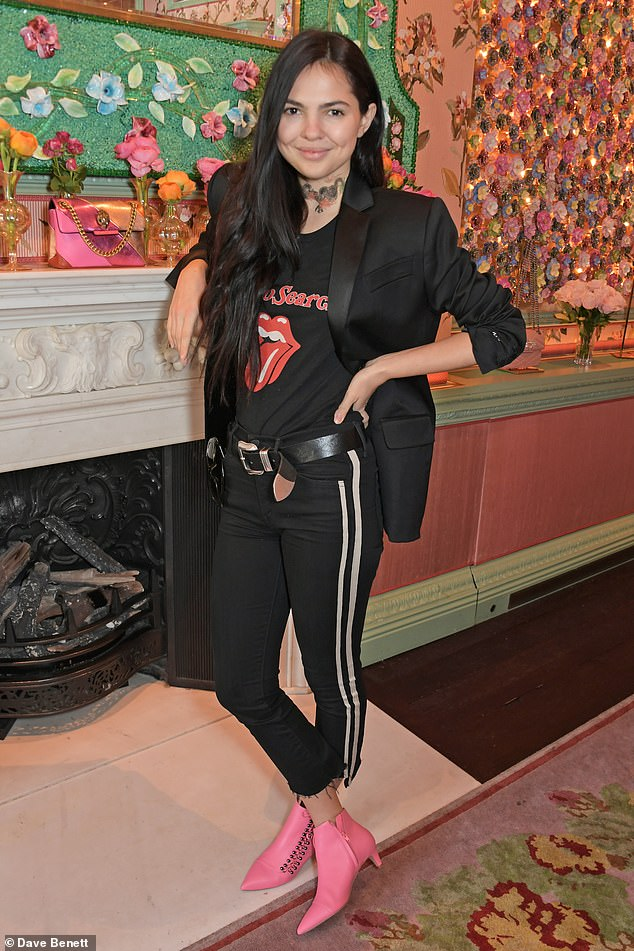 Model and fashion blogger Doina Ciobanu wore her bright pink pair with an all black outfit and choker at a LFW event