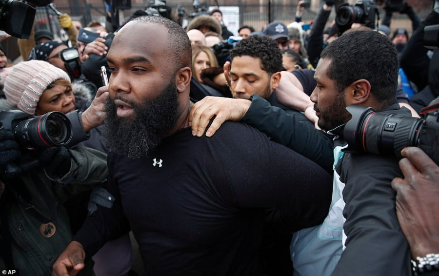 Smollett said nothing and held on to his security guard who led him through a crowd of photographers outside the jail