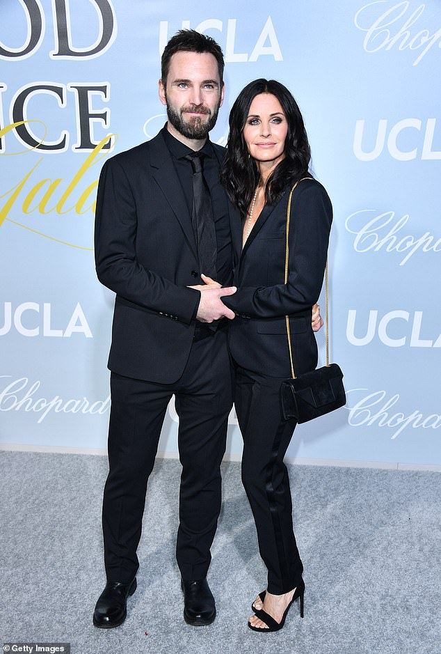 Cute couple: The pair looked closer than ever as they cosied up on the red carpet