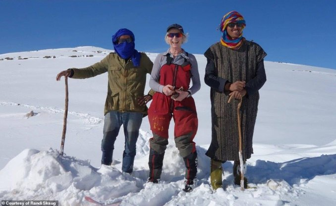 Norwegian explorer Randi Skaug, 59, likes going to remote areas to ski and Mongolia is next on her list. Above, she is pictured with two friendly locals during her ski trip through Iran