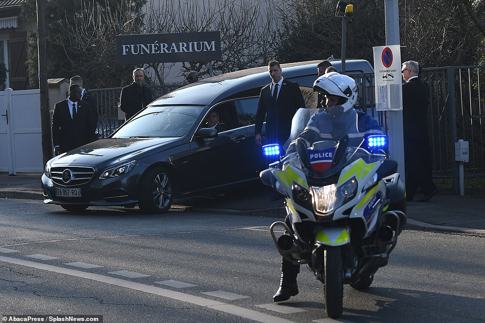 The hearse accompanied by a police escort at the cremation of famous German fashion designer Karl Lagerfeld in Nanterre, near Paris