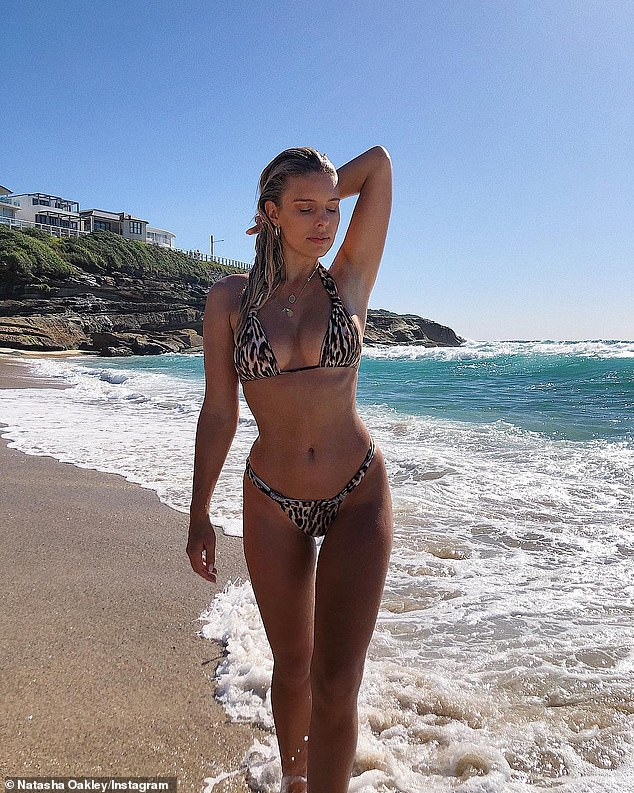 Bronzed beauty: The display of her chic ensemble comes after the model stripped down to a leopard-print bikini for a day out on Sydney's Bronte Beach