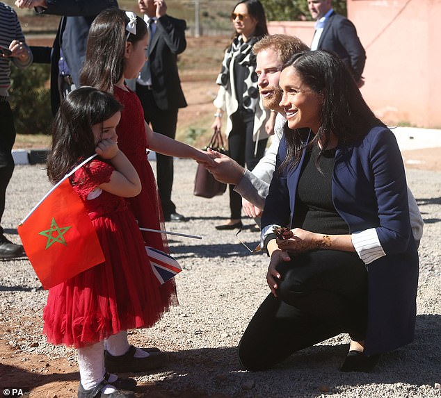 The Duchess of Sussex was seen running over to meet little Rania, five, and Rayhanna, two, as she took a tour of the town of Asni with Prince Harry, 34