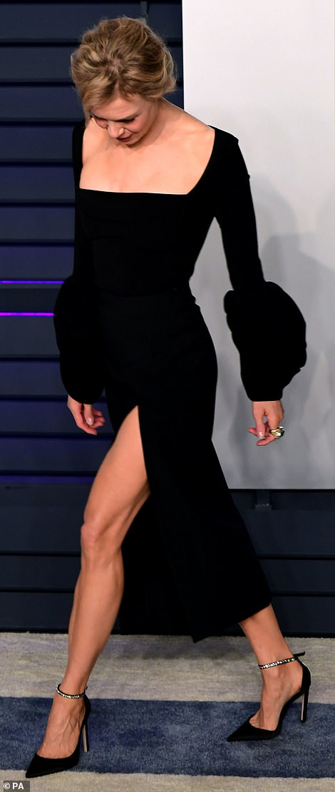 Oscar-worthy look: Renee, 49, opted for a natural makeup look but showed off her toned legs in some some sexy stilettos