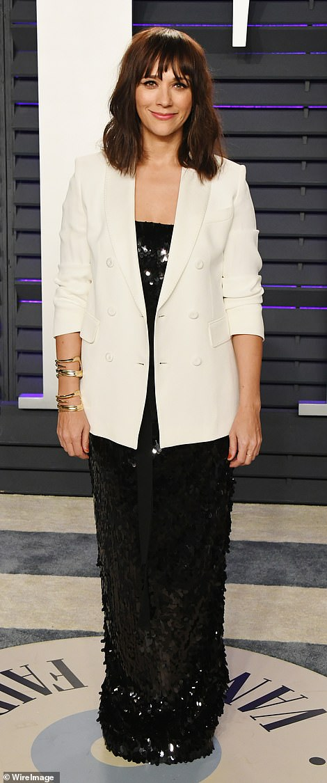 Suits you: DirectorJill Soloway shunned classic cocktail attire while Rashida Jones teamed a cream blazer with a sequinned frock