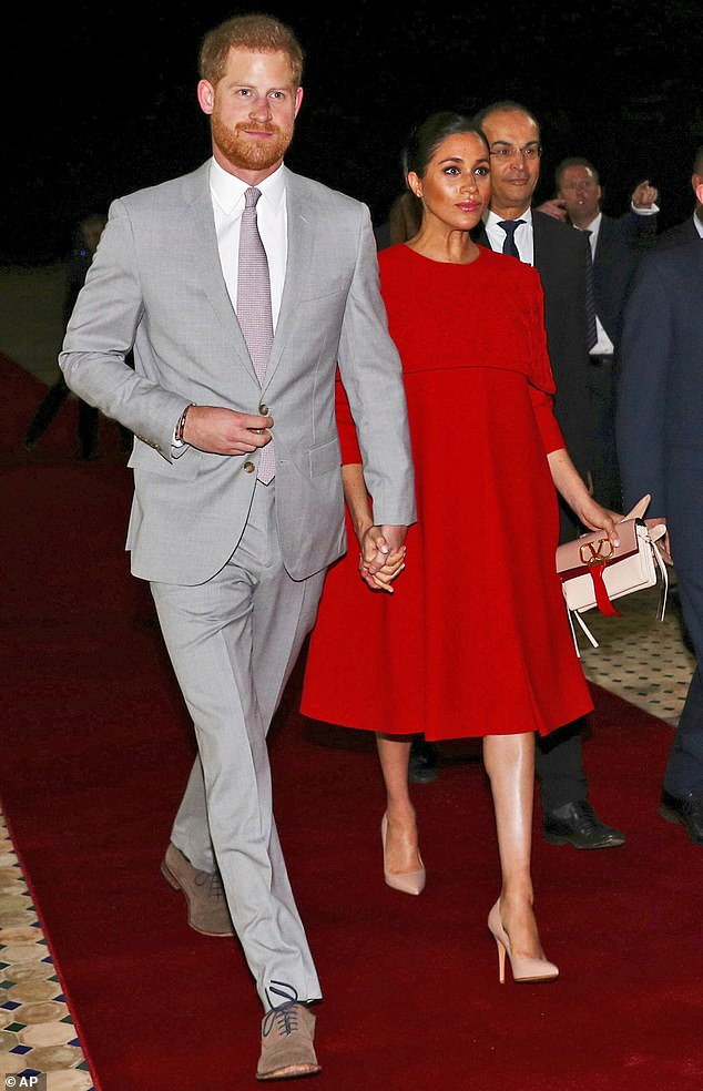 Prince Harry and Meghan Duchess of Sussex, arrive at the Casablanca Airport in Casablanca, Morocco, with Meghan dressed in a stunning custom-made Valentino dress