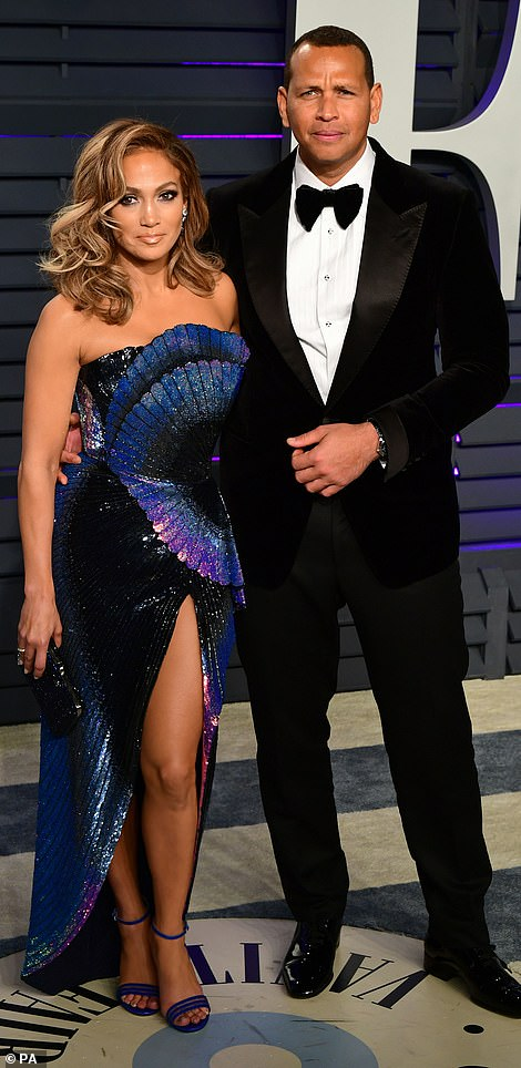 Purple reign: Jennifer Lopez looked incredible in perhaps her best red carpet gown yet as she posed with her love A-Rod