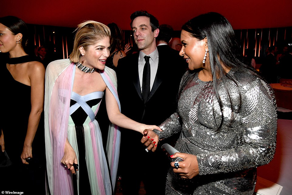 Friends in high places: Selma Blair and Mindy Kaling shook hands as they caught up withB.J. Novak, (centre)