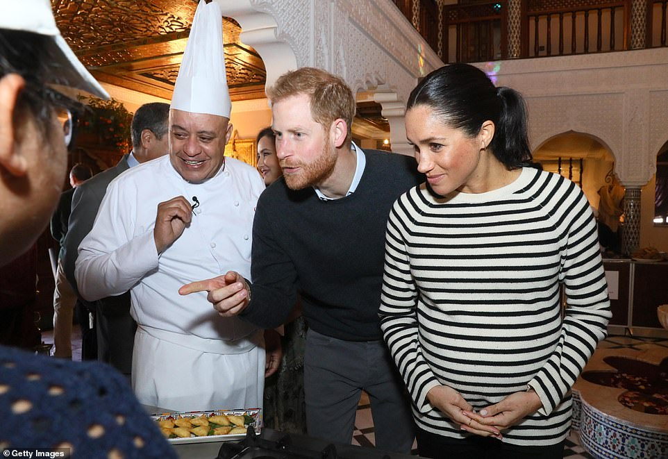 Prince Harry seemed keen to sample some of the the snacks being made by the children at the cookery school today
