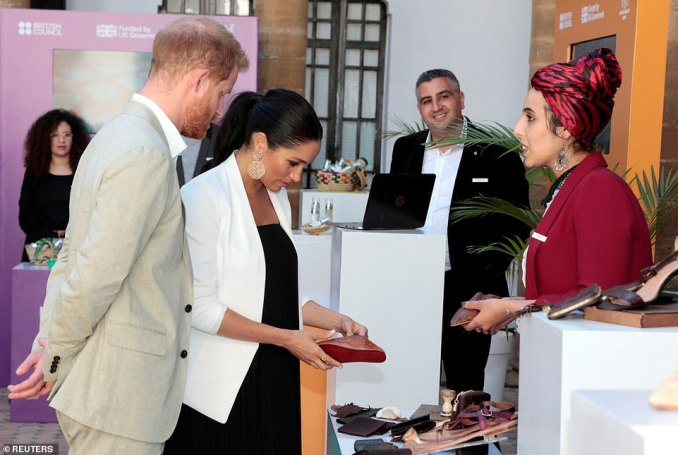 Meghan appeared to have her eye on some locally made shoes as she and Harry touredthe Social Entrepreneurs event and market in the Andalusian Gardens on their final day in Morocco