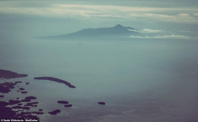 The teardrop-shaped isle - measuring around 25km long and 19km wide - is remote in the truest sense. Above, a view of Karkar flying from Madang to Port Moresby