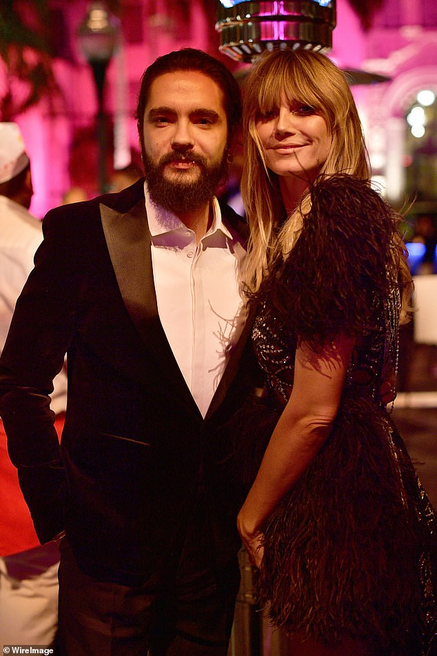 Cosy couple: Tom and Heidi made for a handsome pair as they snuggled up inside the bash