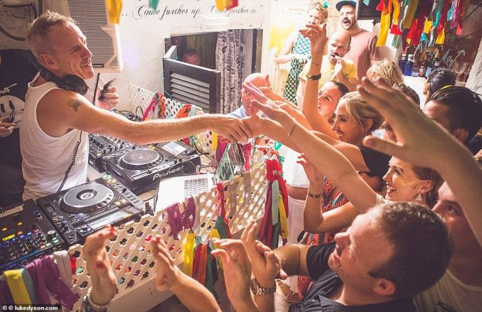 Big-name DJs love Pikes Hotel so much that they happily sign on for a whole summer at the tiny club. Pictured is Fatboy Slim wowing revellers at the hotel