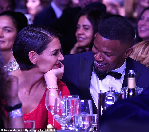 Still on? Foxx hasn't been pictured with his girlfriend of four years - Katie Holmes - since December 28 when they kissed aboard a yacht off the coast of Miami (pictured 2018)