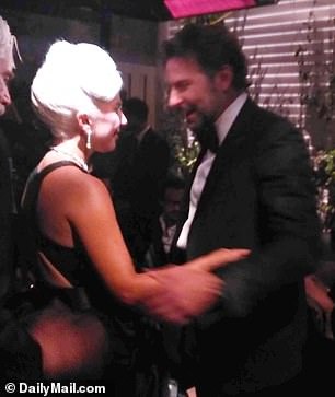 Lady Gaga and Bradley Cooper at the Warner Brothers Oscars party